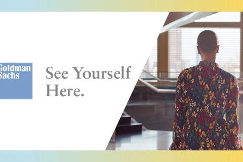 Zdjęcie poziome przedzielone na 2 strony. Po prawej osoba stojąca tyłem w kolorowej koszuli na tle wnętrza budynku. Po lewej na białym tle napis: See Yourself Here.