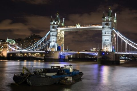 Brightly-lit Tower Bridge in London at night